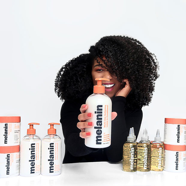 Whitney White with Melanin Haircare products