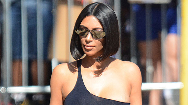Kim Kardashian Rocks A Brown Bikini As She Snuggles With Daughter North West, 7, On A Beach.jpg