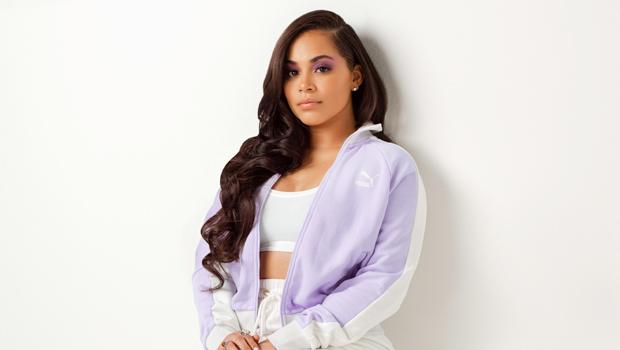 Lauren London Rocks Purple Puma Jacket & Sneakers To Celebrate International Women's Day