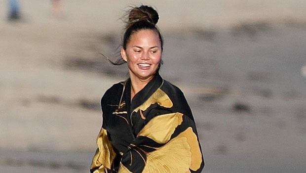 Chrissy Teigen, 35, Slays In Plunging Purple Swimsuit On Vacation With John Legend & Kids
