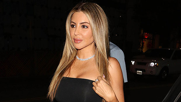 Larsa Pippen Rocks A Fitted Black Tank Top As She Declares She's 'Blessed' Posing With $200K Ferrari.jpg