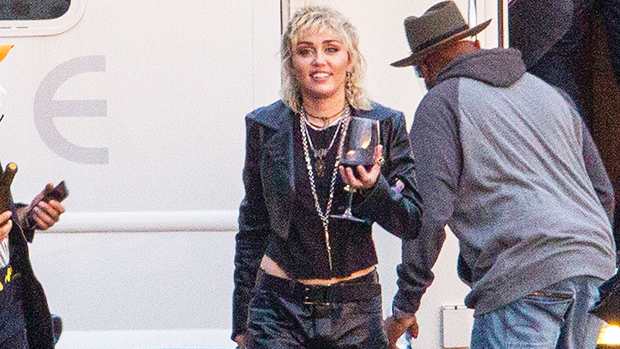 Miley Cyrus Rocks Low-Rise Leather Pants & Cropped T-Shirt On Photo Shoot Set — Pics