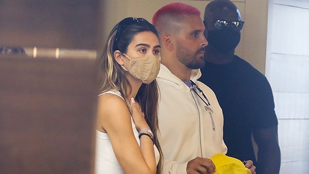 Scott Disick & Amelia Hamlin Wrap Their Arms Around Each Other Back In LA After Miami Getaway
