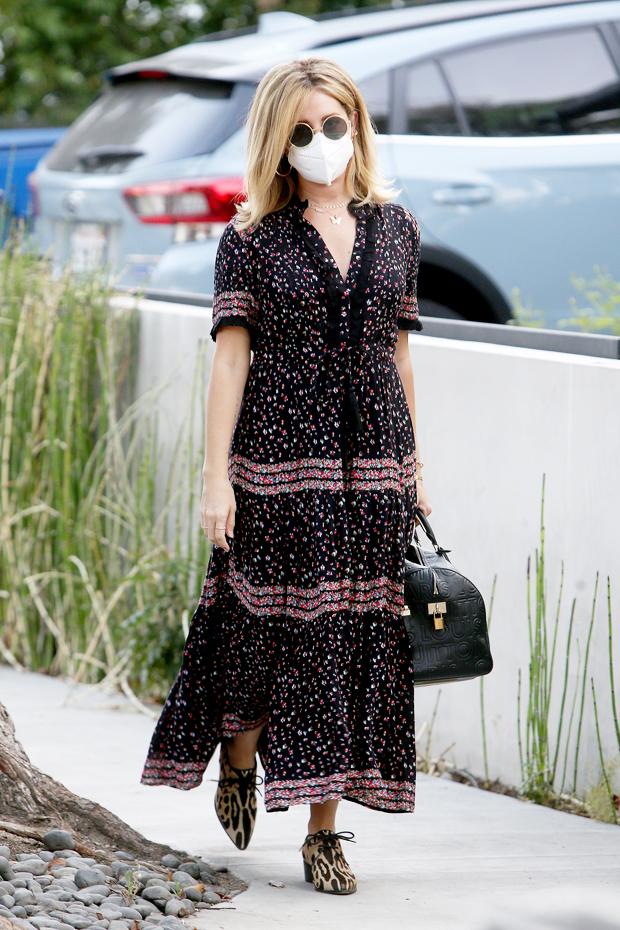 Ashley Tisdale wearing a flowy maxi dress