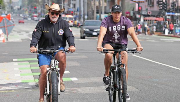Joseph Baena, 23, Bonds With Dad Arnold Schwarzenegger On Venice Beach Bike Ride — See Pics.jpg