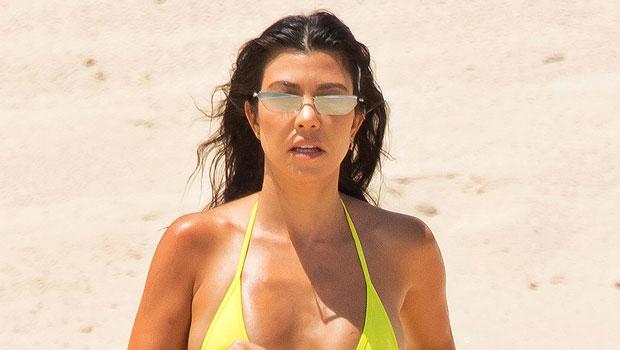 Kourtney Kardashian Devours A Burger In A Pink String Bikini While Posing Poolside — See Pic.jpg