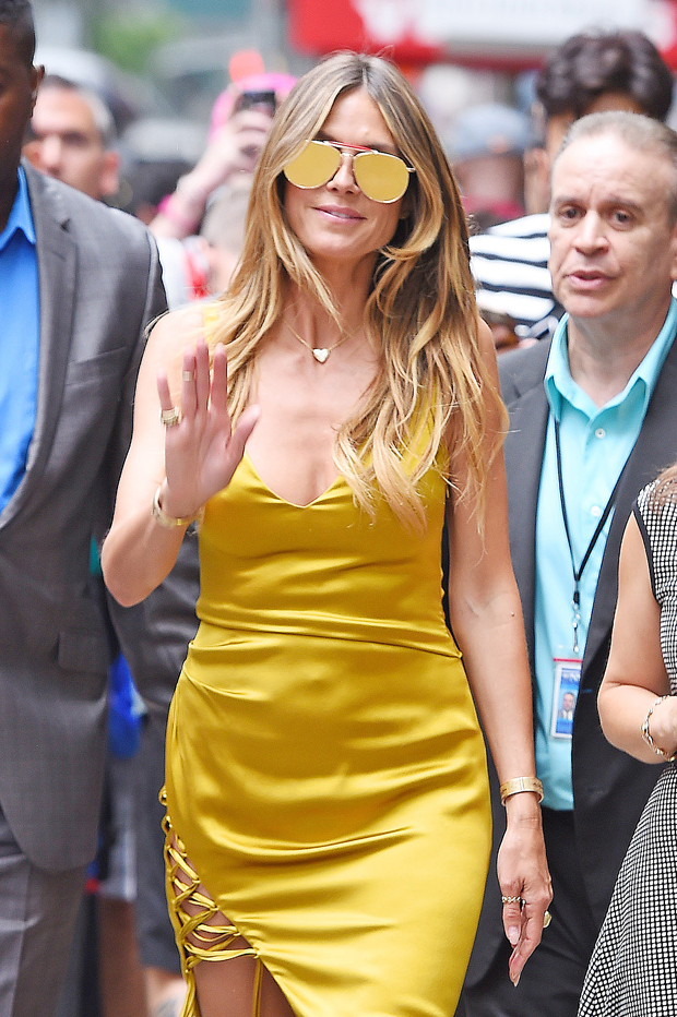 Heidi Klum wearing aviator sunglasses
