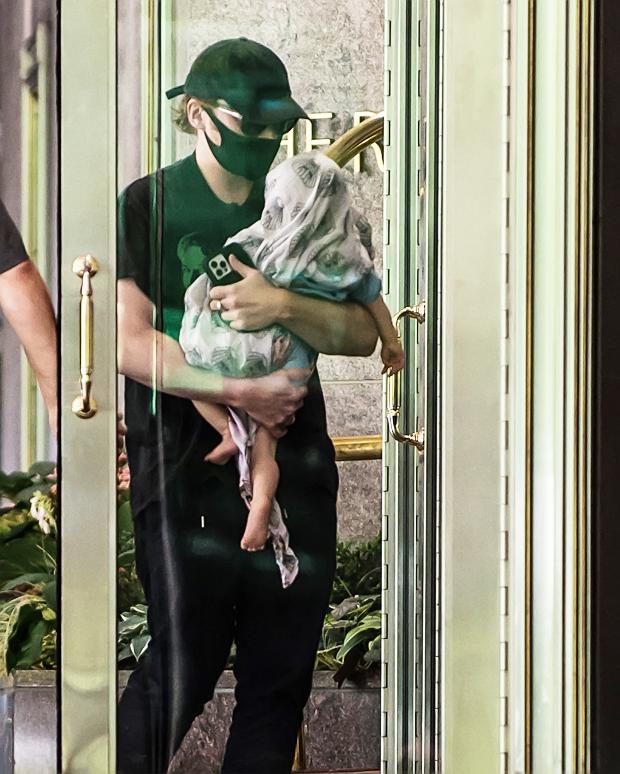 Rupert Grint and his newborn