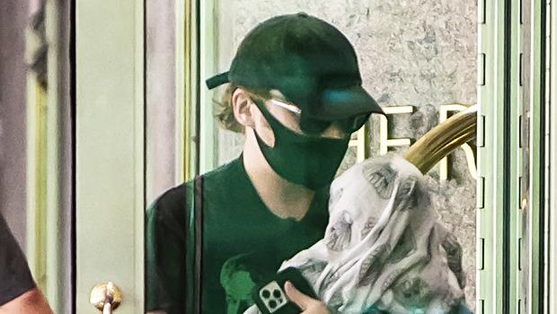 Rupert Grint Cradles Newborn Daughter In Sweet Photos As He Heads To Work On Show Set.jpg