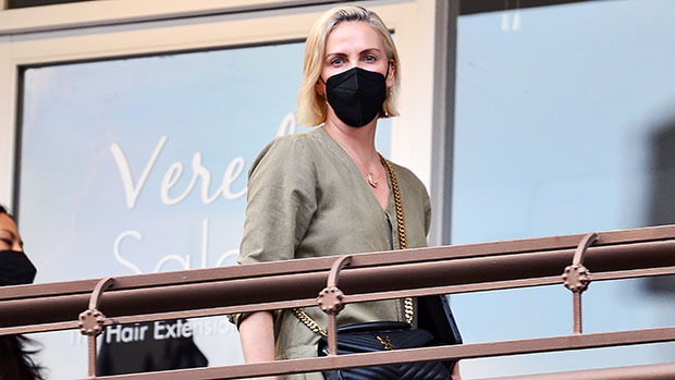 Charlize Theron Glows In A Green Jumpsuit On Rare Outing With Daughters Jackson, 9 & August, 5 — See Pics thumbnail