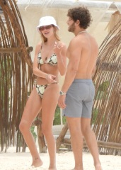 Delilah Hamlin kisses boyfriend Eyal Booker during a beach day in Mexico with her parents Lisa Rinna and Harry Hamlin. The 23-year-old eldest daughter of Housewives of Beverly Hills star looked stunning in a bikini as she embraced the Love Island star. Lisa, 57, and LA Law actor Harry, 69, have joined their daughter in the Mexican resort of Tulum. 15 Jun 2021 Pictured: Dellilah Hamlin. Photo credit: MEGA TheMegaAgency.com +1 888 505 6342 (Mega Agency TagID: MEGA762770_021.jpg) [Photo via Mega Agency]