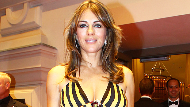 Elizabeth Hurley, 56, Rocks A Yellow Bikini & Dances To Spice Girls With A Friend — Watch.jpg