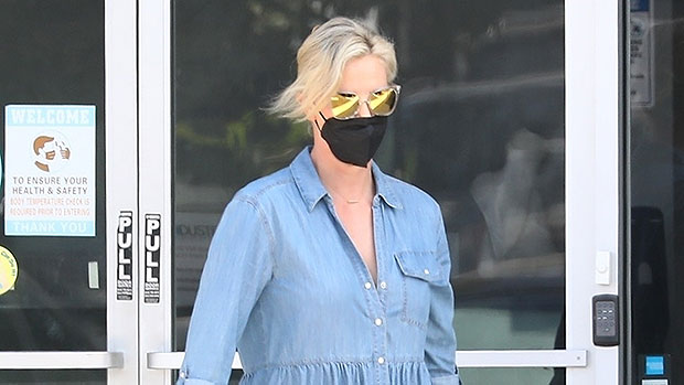 Charlize Theron Steps Out In Denim Mini Dress & Sandals Leaving An L.A. Dance Studio — Photos.jpg