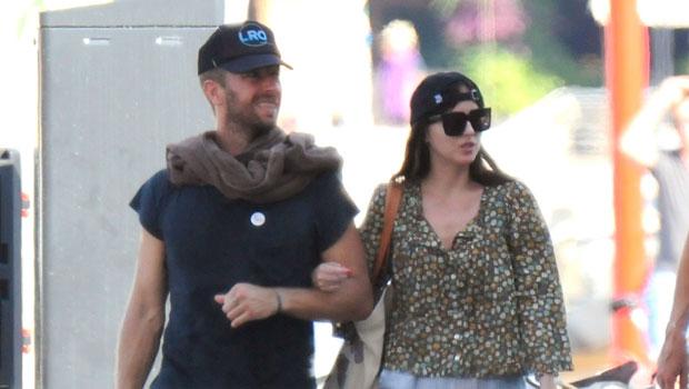Dakota Johnson & Chris Martin Link Arms As They Stroll Around Mallorca On Romantic Getaway — Photos