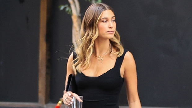 Hailey Baldwin Tries On Open Black Top & Black Mini Dress For An Evening Out — See Photos.jpg