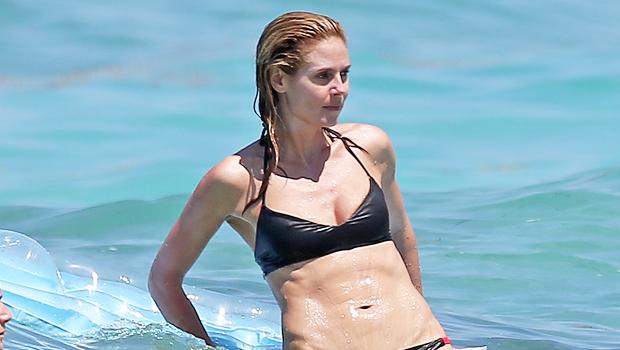 Heidi Klum, 48, Sunbathes On A Boat In Stunning Purple Bikini — Photos.jpg