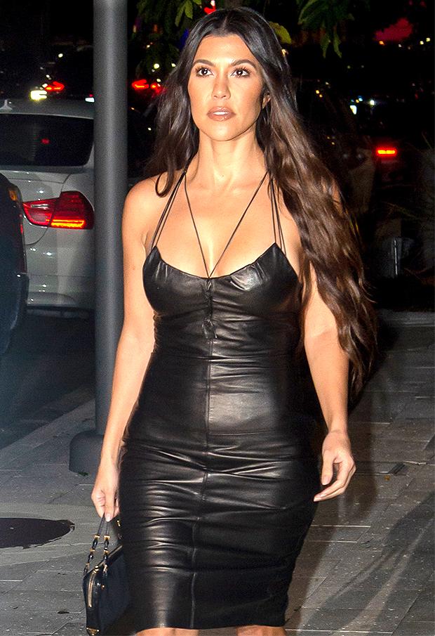 Kourtney Kardashian puts on quite the show in her latest photos.
