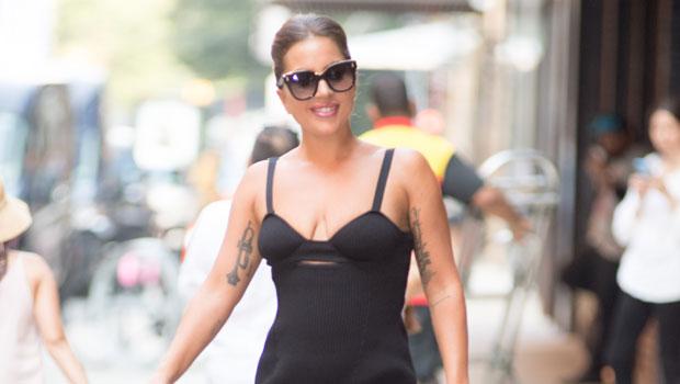 Lady Gaga Turns Heads In NYC Strutting Around In Oversized Platform Boots & Elegant Black Dress