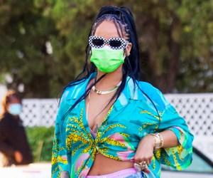 Rihanna wearing a flowy button down shirt