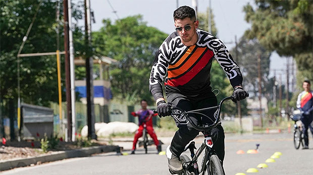 Nick Jonas Crashes His Bike & Has To Be Taken To The Hospital In 'Olympic Dreams' Special