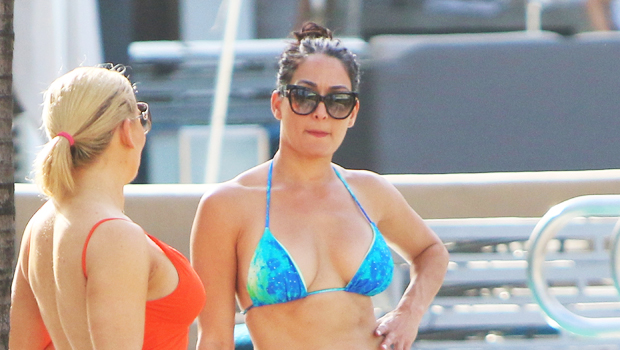 Nikki Bella Pours Wine While Rocking A Bikini By The Pool For 'Sister Sunday' — Watch.jpg