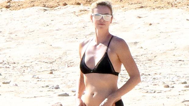 Charlize Theron, 45, Rocks A Black Bikini While Hitting A Luxury Yacht In Greece — Photos.jpg