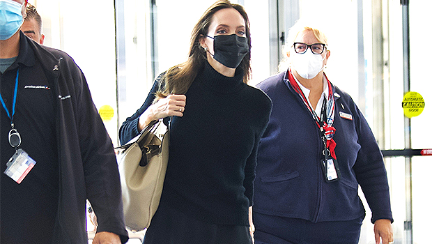 Angelina Jolie Rocks Black Turtleneck & Matching Skirt At LAX After Meeting With U.S. Gymnasts