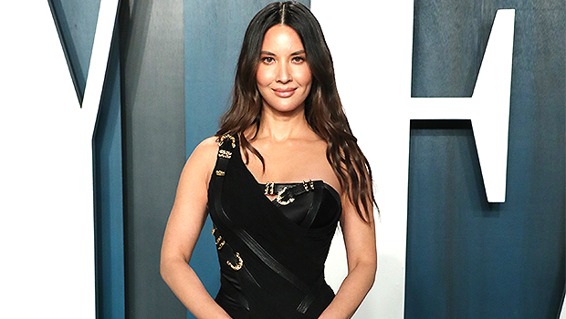 Pregnant Olivia Munn Cradles Her Dog On Her Baby Bump In Sweet New Photo.jpg