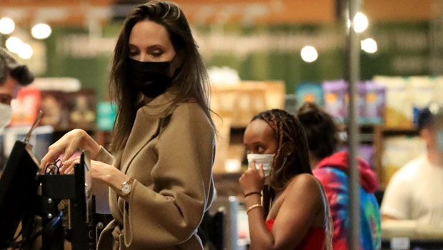 Angelina Jolie's Daughter Zahara, 16, Is Stylish In A Red Dress On Grocery Store Run With Mom