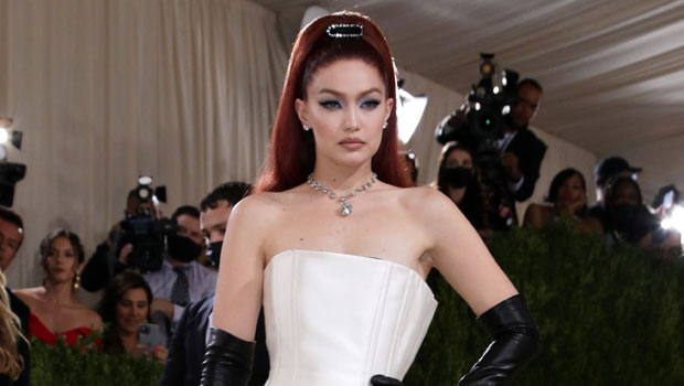 Gigi Hadid Dons Vibrant Red Hair & A White Column Gown While Gushing Over Baby Khai At The Met Gala.jpg