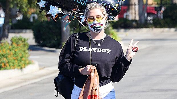 Kesha Sports White Daisy Dukes & A 'Playboy' Sweatshirt As She Flashes A Peace Sign — Photos.jpg