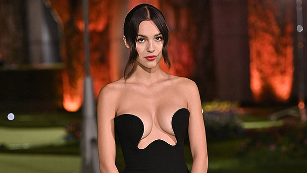 Olivia Rodrigo Is Gorgeous In A Strapless Plunging Black Gown At Oscars Museum Party.jpg