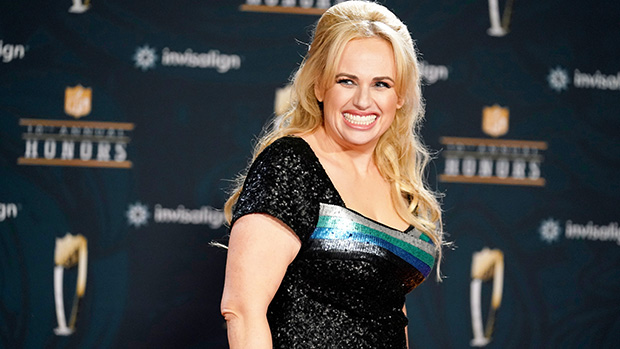 Rebel Wilson Emerges From The Water In Low-Cut Black Swimsuit – Photo.jpg