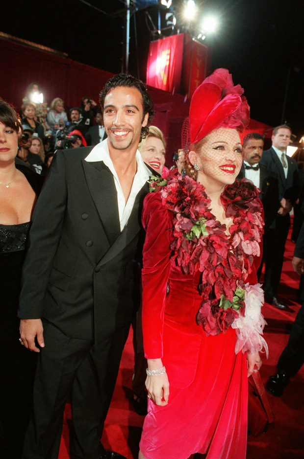 """CARLOS LEON MADONNA Evita"""" star Madonna and Carlos Leon, father of their infant daughter, arrive for the film's premiere, at the Shrine Auditorium in Los AngelesEVITA OPENING, LOS ANGELES, USA"""