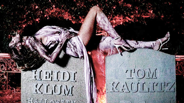 Heidi Klum Lays Across Her Tombstone Covered In Blood & Bandages For Halloween Surprise.jpg