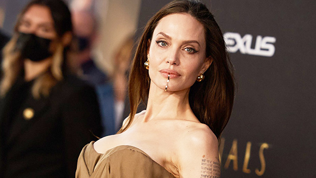 Angelina Jolie Rocks Unique Gold Chin Cuff As She Stuns On 'Eternals' Premiere Red Carpet