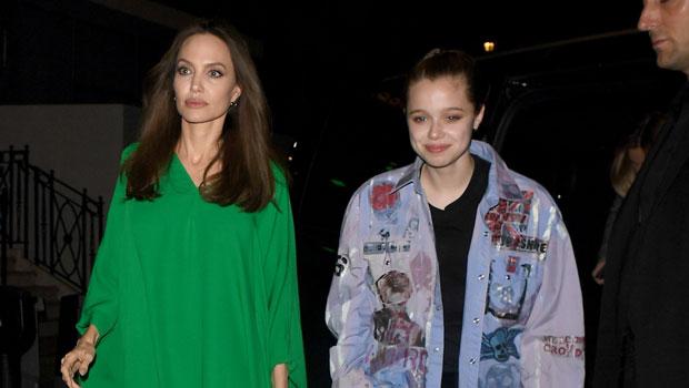 Shiloh Jolie-Pitt Rocks A Jean Jacket While Sister Zahara Wears A Yellow Dress Out With Mom Angelina.jpg