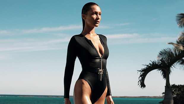 Bella Hadid Transforms Into A Bond Girl In Plunging Swimsuit For New Michael Kors Campaign – Photos.jpg